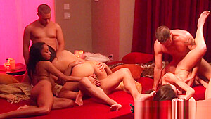 Young couples perform erotic scenes in the Red Orgy Room American swinger couples on national TV-
