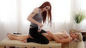 Redhead Les masseuse pussylicking with client