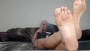 Sexy amateur MILF with dirty feet gets secretly filmed on the sofa