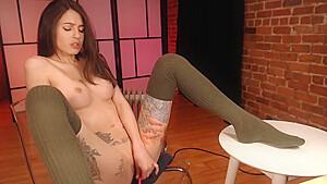 Cute tattooed slut squirts on cam