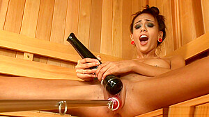 Skinny tanned babe is machine fucked