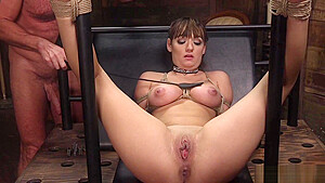 Babe locked in wooden stock stand