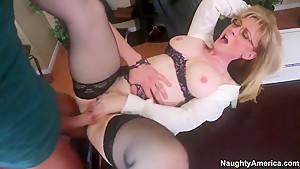 Mature teacher Nina Hartley spreads her legs in front of her young student Xander Corvus