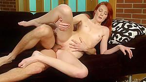 Redhead gets fucked forwards, backwards and sideways on the sofa