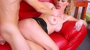 Curly hair blonde spread legs wide on sofa