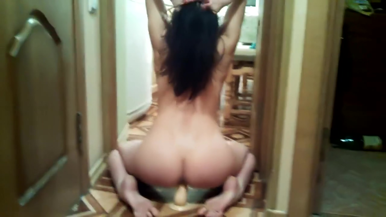Solo babe riding a dildo