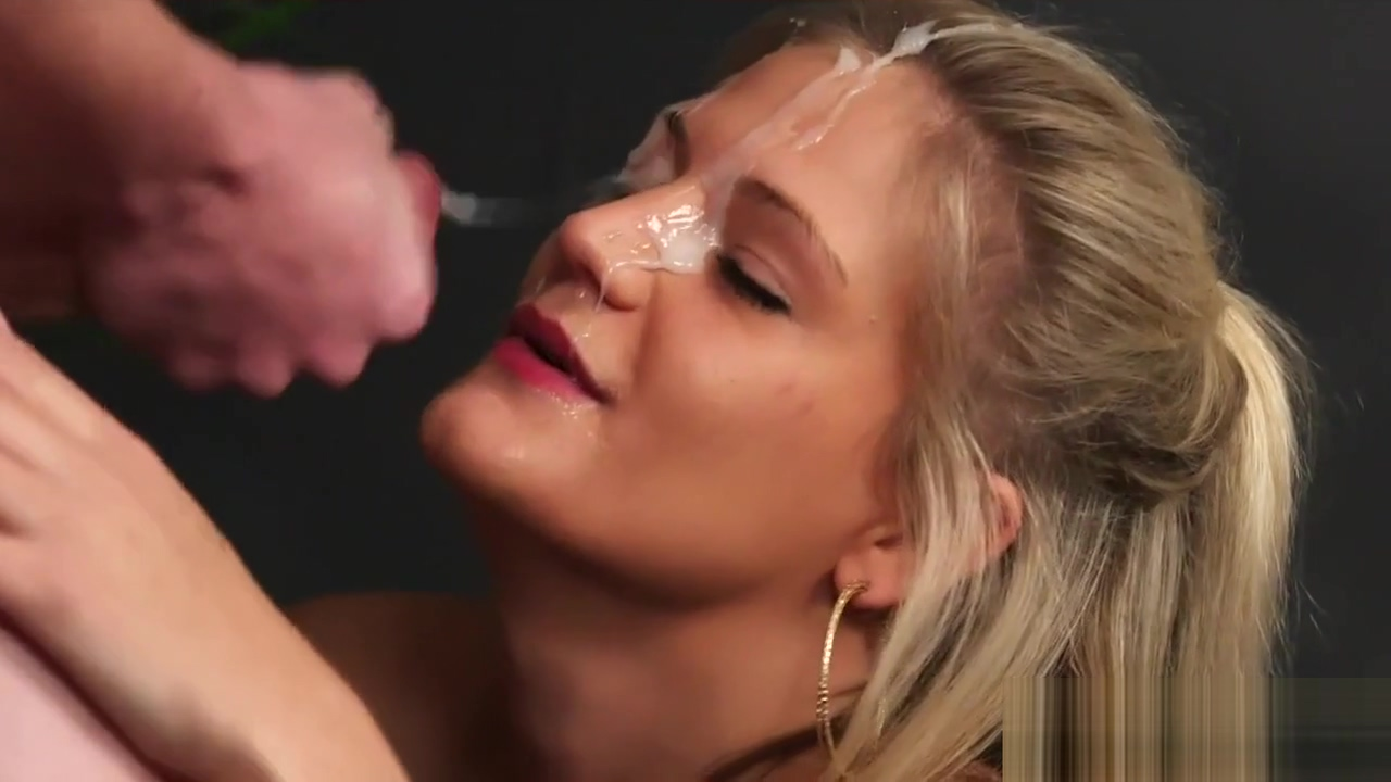 Sexy hottie gets cum load on her face eating all the cream