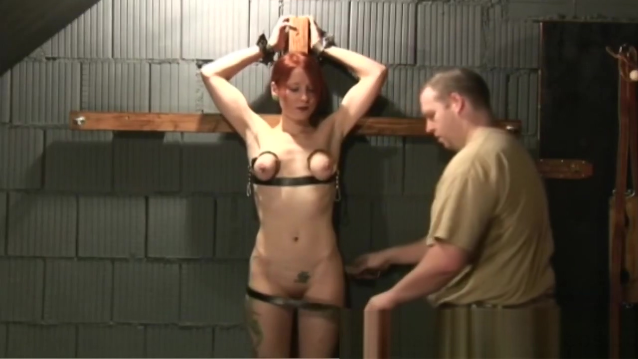 Beautiful redhead tied up by chubby dude who whips her