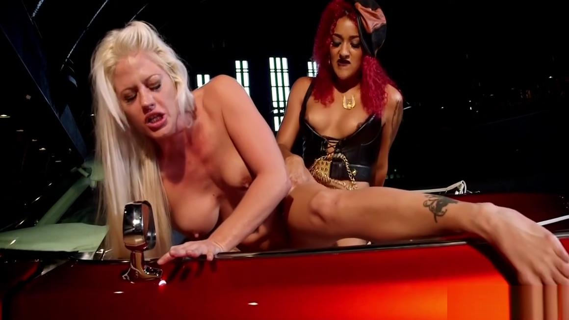 Ebony anal fucks blonde in roadster