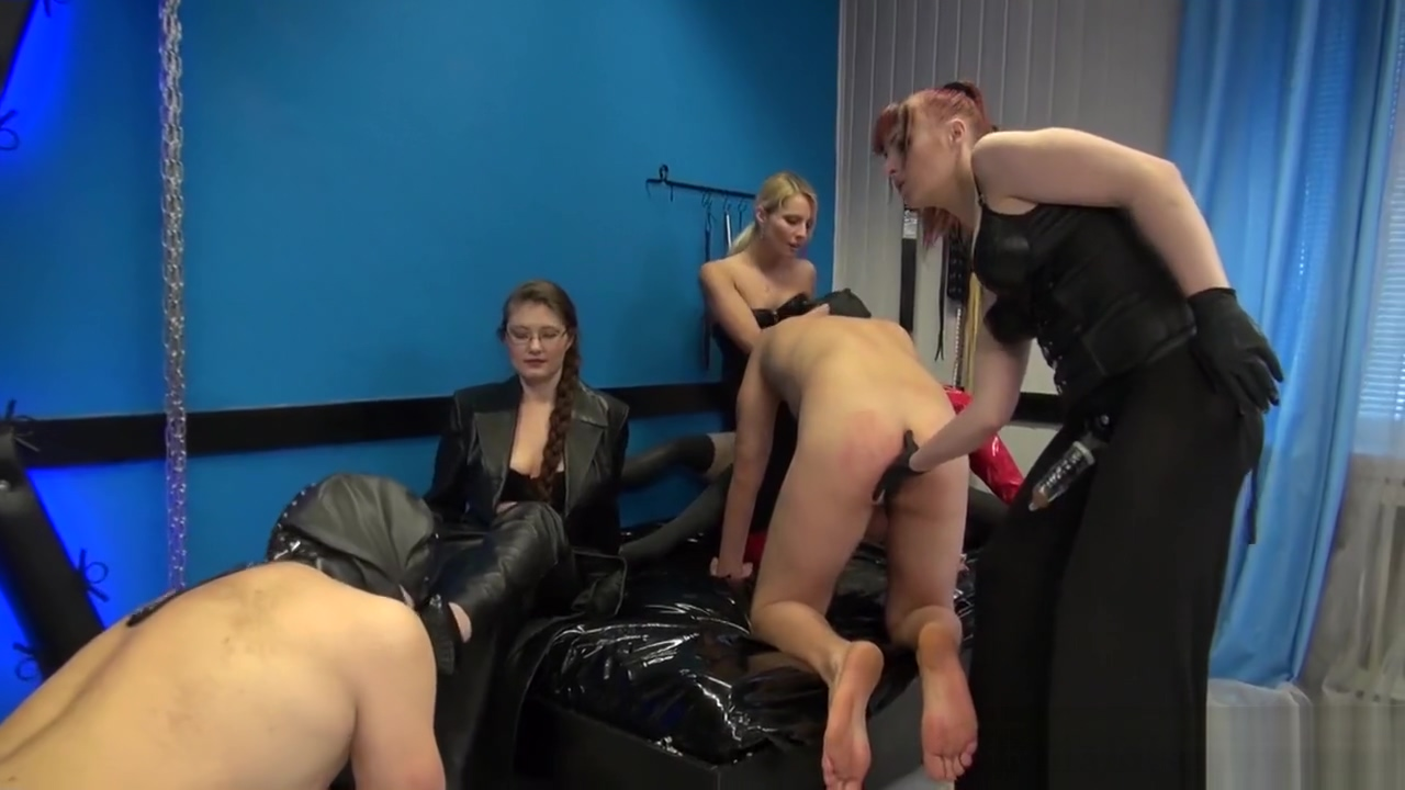mistress in red thigh high boots and her 2 friends have fun with 2 slaves