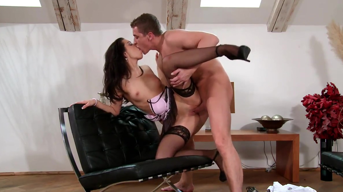 Babe likes to spread her legs in black leather arm chair for pussy to be sucked