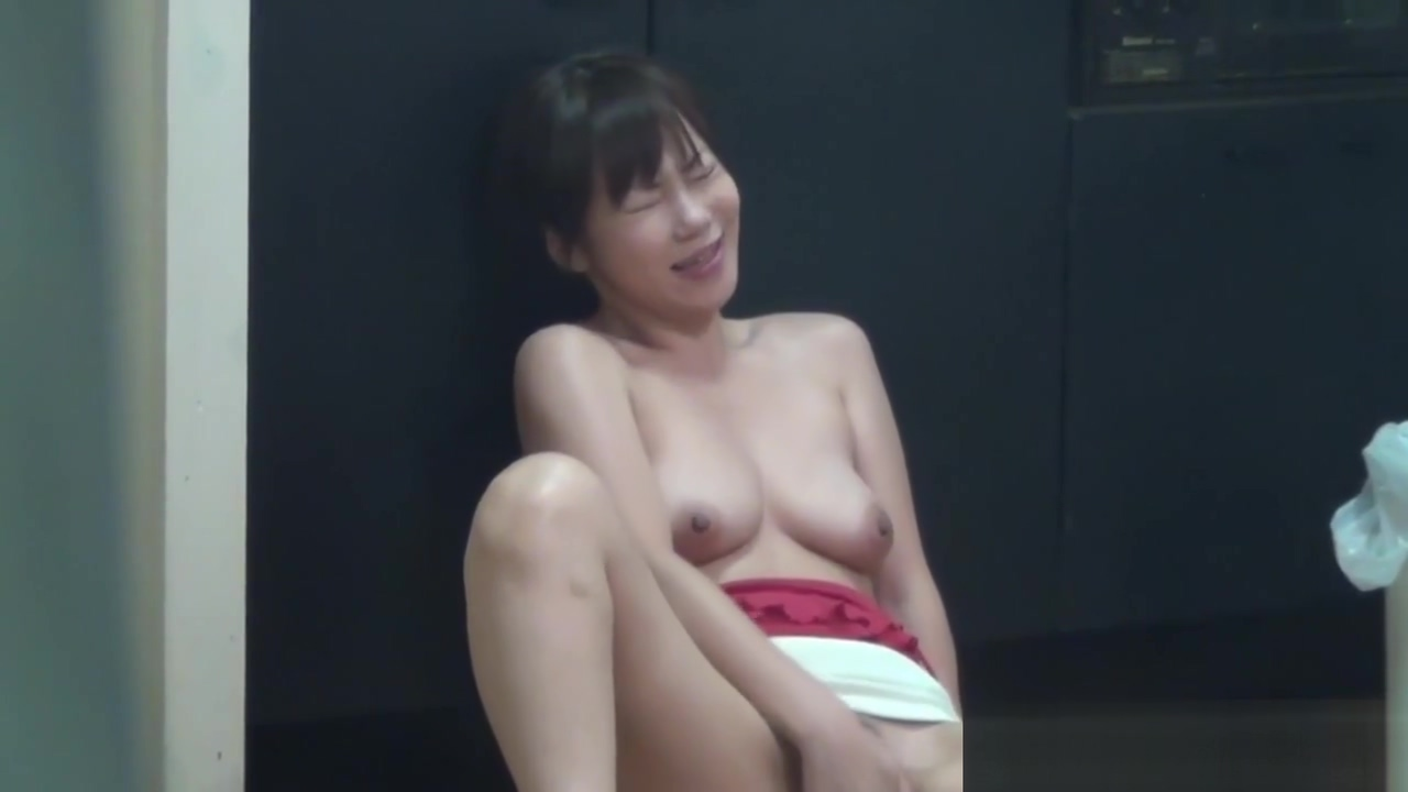 Tiny asian rubs her pussy
